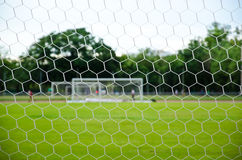 Soccer Net. Close-up of soccer net  with soccer field and some players Stock Images
