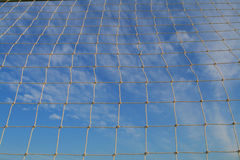 Soccer net. With a blue sky background Stock Photos