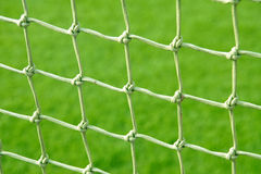 Soccer net. On a green grass background Royalty Free Stock Photo