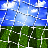 Soccer net against the sky and field Stock Photos