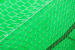 Soccer net on a green background Stock Photo
