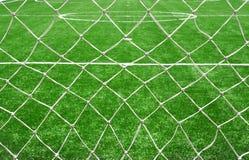 Soccer net on green grass Stock Photos