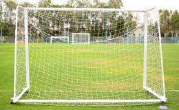 Soccer net on green grass Stock Photography