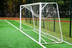 Soccer net on green grass. The theme of sport and health Stock Images