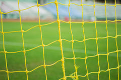 Soccer nets. Yellow soccer nets in the  stadium Stock Photography