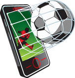 Soccer news on phone Stock Images