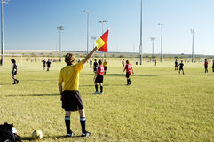 Soccer Official. A soccer official signals a ball out of bounds Stock Photography