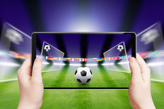 Soccer online, sports game. Abstract technology background - tablet pc, computer in hands, soccer ball, sports game online, soccer online, augmented reality Royalty Free Stock Photos