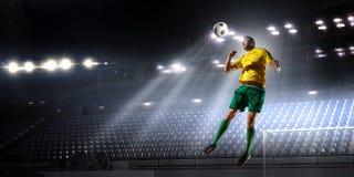 Soccer palyer hit ball . Mixed media Royalty Free Stock Image