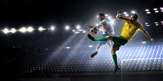 Soccer palyers fighting for ball . Mixed media Royalty Free Stock Images