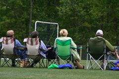 Soccer parents. Moms and dads watching soccer game Stock Photography