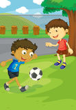 Soccer in the park. Kids playing soccer in the park Royalty Free Stock Photography