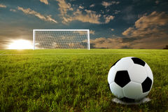 Soccer penalty kick. Soccer ball on penalty disk in sunset time Stock Photos