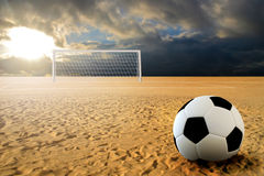 Soccer penalty kick. Soccer ball on penalty disk in sand beach Stock Photography