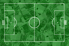 Soccer pitch and banknotes Royalty Free Stock Photo