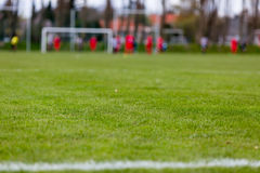 Soccer pitch with blurred players Royalty Free Stock Image