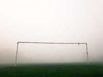 Soccer pitch goal posts in the fog Royalty Free Stock Photos