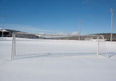 Soccer pitch in winter. Covered with snow Stock Photography