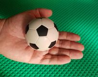 Have the football in the Palm of your hand Royalty Free Stock Photography
