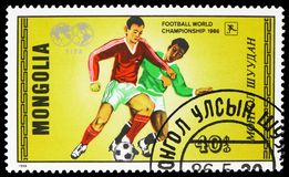 Soccer play, World Cup Football serie, circa 1986. MOSCOW, RUSSIA - MARCH 23, 2019: Postage stamp printed in Mongolia shows Soccer play, World Cup Football serie royalty free stock photos