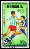 Soccer play, World Cup Football serie, circa 1986. MOSCOW, RUSSIA - MARCH 23, 2019: Postage stamp printed in Mongolia shows Soccer play, World Cup Football serie royalty free stock photo