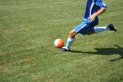 Soccer player. Hitting a ball Royalty Free Stock Image