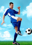 Soccer player. Portrait of soccer player hitting the ball royalty free stock photo