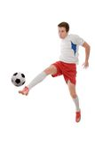 Soccer player. Kicking the ball isolated on white Stock Images