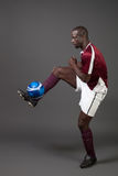 Soccer Player. Male soccer player. Studio shot over grey Stock Image