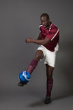 Soccer Player. Male soccer player. Studio shot over grey Royalty Free Stock Photography