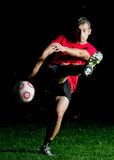 Soccer player. Shooting a ball Stock Images