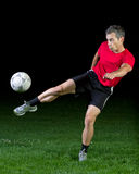 Soccer player. Shooting a ball Royalty Free Stock Photography