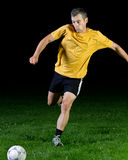 Soccer player. Shooting a ball Stock Image