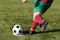 Soccer player. A soccer player ready to score a penalty Stock Image