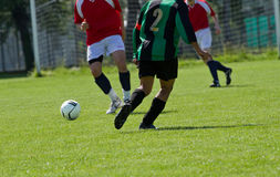 Soccer player. Running after the ball Stock Images