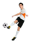 Soccer player. Shooting a ball isolated on white background Royalty Free Stock Image