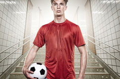 Soccer player. Young soccer player in gray tunnel Royalty Free Stock Photography