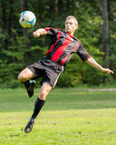 Soccer player. Kicking a ball in a bicycle kick royalty free stock images