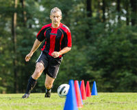 Soccer player. Dribbling with a ball stock photography