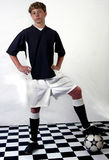 Soccer player. Teenage boy in soccer uniform posing with ball Royalty Free Stock Images