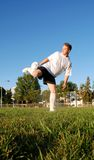 Soccer player. A soccer player in a field Royalty Free Stock Image