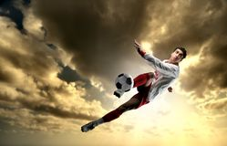 Soccer player. A young soccer player in acrobatics Royalty Free Stock Images