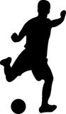 Soccer Player with Ball Silhouette Royalty Free Stock Photos