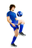 Soccer Player. A male soccer player. Studio shot over white Royalty Free Stock Photos