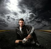 Soccer player. On the street Stock Images
