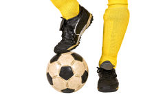 Soccer player. Isolated legs and soccer ball Royalty Free Stock Images