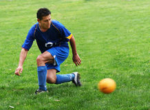 Soccer player. Hitting a ball Stock Images