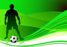 Soccer Player on Abstract Green Background Royalty Free Stock Photo