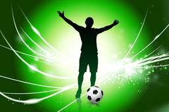 Soccer Player on Abstract Green Light Background Royalty Free Stock Image