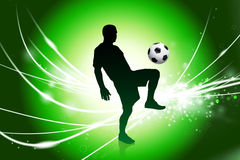 Soccer Player on Abstract Green Light Background Stock Photo